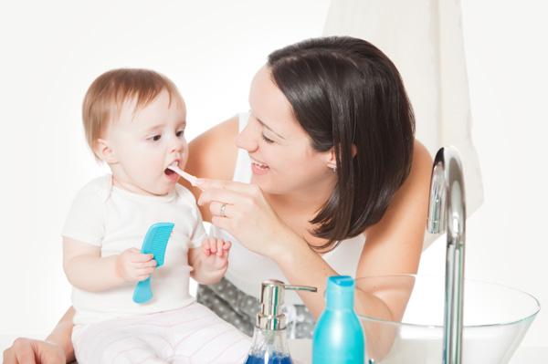 mom-brushing-baby-teeth